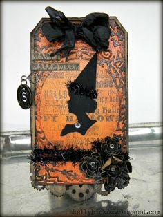 Shelly Hickox' version of Tim Holtz August 2012 tag.  Stamptramp