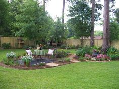Love this backyard, blog post shows awesome before and afters. I want to do something similar with the kids' swingset incorporated