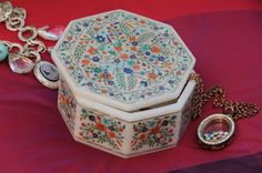 """Product Description - 4"""" octagon, mastercrafted box  No. of stones - 5000  The word USTAD comes from the Persian word meaning Master. Here at Akbar , we have the privilege of having such few few Master Artists / Ustads. An Ustad can create a complete flower with 50 number of individual stones in a diameter of 0.25 cm. This requires immense patience and total mastery of the tools and art.  Visit our official website www.akbarinternational.com to know more about Parchinkari or call us to book…"""