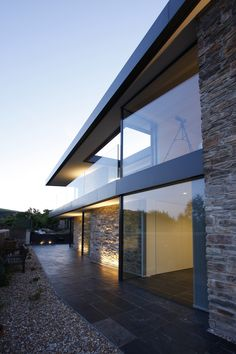 fixed structural glass wasused on both floors as frameless windows  www.iqglassuk.com