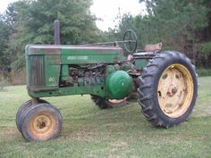 Old John Deere tractor.....my grandpa would give me a ride all over San Eli