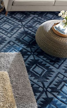 The Lada Rug is true blue. Skilled weavers have taken the traditional geometric motifs of a tribal rug and scaled up the geometric shapes for a borderless, streamlined rug that is nothing less than a modern heirloom.