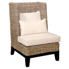 Handmade rattan wingback chair with a mahogany frame and neutral upholstery.  Product: ChairConstruction Material: