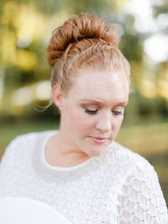 You can't go wrong with a messy top knot.  Photo | Rachel May Photography