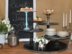 Recreate this for about 10-bucks!!  Use wooden ovals, rounds from Hobby Lobby and thrift find candle sticks and voile!  Beautiful for serving your yummy baked sweets.  Great to display your dishes for buffet style dinners.