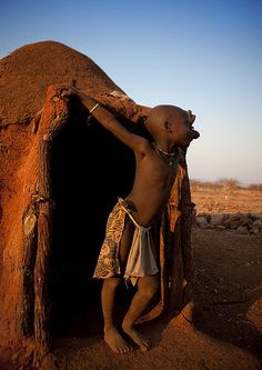 Himba house at sunset - Namibia by Eric Lafforgue