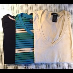3 t-shirts! 2 V necks and one crew neck. 3 t-shirts 2 v necks and 1 crew neck. The black one is S.O. And has been worn 1 or 2 times. The striped one is B.D.G. and is in good/used condition, the pale yellow one is from Wet Seal and has 2 small marks on the front of it (see photo) but they are barely noticeable. BDG Tops Tees - Short Sleeve