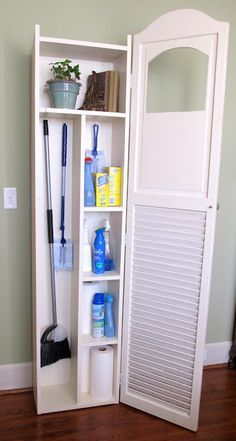 """$15 bi-fold louvered doors;took one of the doors and flipped it upside down. Using a jigsaw, I cut the decorative top edge and the little """"peek-a-boo"""" hole. The cabinet body was made from 1x10's and the shelves were arranged to accommodate all my cleaning supplies.A few pieces of scrap wood trim and a plastic Goodwill doo-dad to jazz it up a bit."""