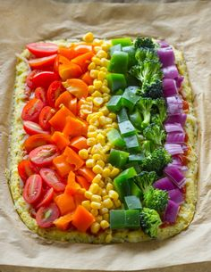 Low-carb Cauliflower crust rainbow pizza is packed with veggies inside and out, and is perfect for kids and adults. Rainbow Pizza, Rainbow Food, Healthy Vegan Snacks, Healthy Eating, Healthy Recipes, Pizza Recipes, Vegetarian Recipes, Cooking Recipes, A Food