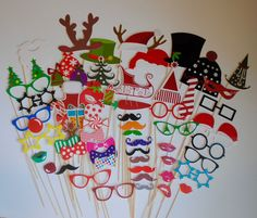 60 piece set of handmade pre-assembled Christmas theme photo booth props, perfect for your holiday party! Props are made of of heavy duty card stock and attached to a wooden dowel. Copyright © 2016 by