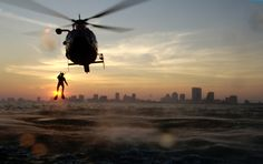 U.S. Coast Guard rescue swimmer entering a Atlantic Ocean