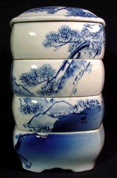 Seto porcelain Jubako/Danjo boxes  Bright cobalt and densely pigmented karakusa (scrolling arabesque pattern) are typical of Seto porcelain.  tokyojinja.com jubako-stacking-bowls-japan-327x499