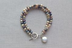 How to Keep Jewelry Clasps Out of Sight: Multi-colored freshwater pearl bracelet with coin pearl dangle
