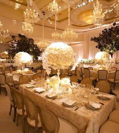 Crystal chandeliers cast light on glimmering gold hues at this @Beverly Wilshire (A Four Seasons Hotel) Grand Ballroom reception.