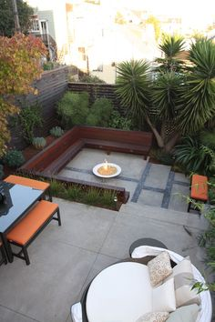 A dish-shaped fire pit adds a futuristic element to this geometric backyard. Via Outer Space Landscape Architects