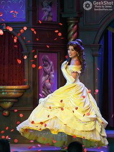 Belle in love and roses. Beauty and the Beast play at the Fantasy Faire Royal Theater in Disneyland. Disney Princess.