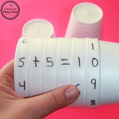 Looking for a Cool Math Activity for Kids? These Cup Equation Spinners are simple, versatile and fun. Practice lots of fun math skills with just a few cups.