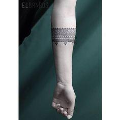 Ornamental style arm band tattoo on the left forearm. Tattoo artist: Elda…