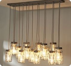 I love this mason jar chandelier! I saw a similar one on the Rachel Ray Show where they hung a wine crate with mason jars instead of drilling a wood plank into the ceiling. Not too difficult of a project either. Check out the website for instructions.