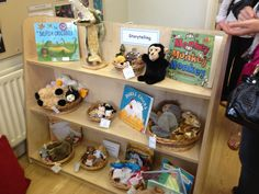 Book area at Early Excellence great idea having puppets linked to each story