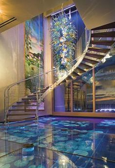 I saw this on HGTV last night. Totally totally my true DREAM house. Water floors with glass over. A waterfall window. And a crystal chandelier! <3
