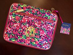 This folio lets you carry everything you need in style! With multiple pocket sizes, its the perfect accessory to your accessories! Carry your Lilly
