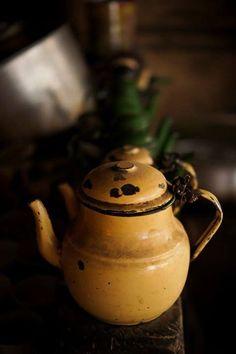 Old golden farmhouse teapot.