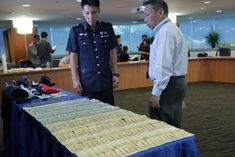 Malaysian robbed of $365000 in cash when he met bogus Bitcoin seller and broker