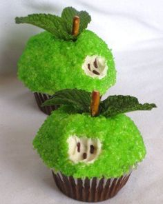 Too cute! Apple Cupcakes: Cover a cupcake in vanilla frosting. Next, roll the top in green sprinkles, insert a pretzel stick & mint leaves. Last, use a child's fork to take a 'bite' out of it and add three brown sprinkles for apple seeds.