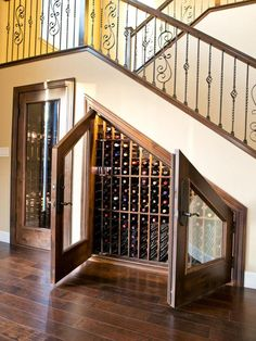 Decorations:Appealing Under Stairs Wine Cellar Storage With Glass Door Also Brown Laminate Wooden Floor Smart Utilization Under Stair Wine Storage Ideas