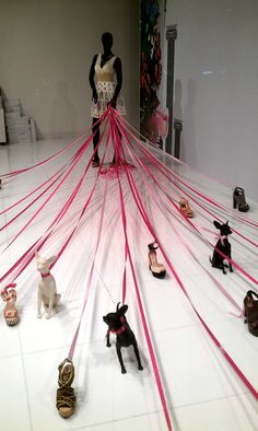 Maybe a dog holding the leashes of smaller dogs/cats draped with the collars for a pet window.