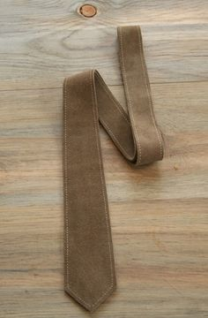 Taupe stitched leather tie.JPG