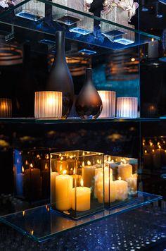 The warm glow of candlelight, illuminates this dramatic vignette. #WeddingDecor
