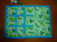 Quilted Mug rug. tic-tac-toe or naughts & crosses in blue and green.