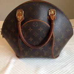 Louis Vuitton Ellipse Authentic LV Ellipse in very good condition.  This is the larger style. Date Code is MI0011 located under the inside tab. Leather has darkened to a rich hue.  Exterior and interior are in very good condition with no rips, tears, stains or marks.  Hardware has lost a bit of it's shine. No lock or dust bag. Carrying this bag will add instant class to any outfit you wear it with. No trades. Louis Vuitton Bags