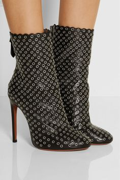 ALAÏA Eyelet-embellished Leather Ankle Boots | $2172 BUY ➜ http://shoespost.com/alaia-eyelet-embellished-leather-ankle-boots/ Crafted in Italy with a scalloped top, Alaïa's black leather boots have standout appeal. A hidden internal platform lends it a manageable lift, while silver eyelets give it tough-luxe edge. Keep yours in focus against a high-hemmed dress.