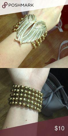 NWOT Angel wings bracelet Gold and crystal angel wings bracelet. Beautiful statement piece. Jewelry Bracelets