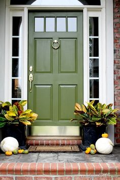 Fall Front Door Refresh. The brass door knocker and Entry handle are gorgeous with this green door.