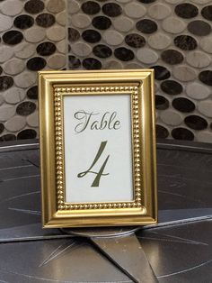 Set of stunning gold vintage inspired framed table numbers. These classic frames will add an elegant look to your next big special occasion. Frames are made from aluminum, they are finished in a magnificent shiny gold tone with a delicate inner border of beading. Each frame features a stylish black velvet backing and can stand vertically or horizontally. Our vintage inspired frames can be used as a table number frame, place card holder, picture frame, wedding party or party favor for your…