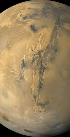 Valles Marineris: The Grand Canyon of Mars ~ The largest canyon in the Solar System cuts a wide swath across the face of Mars, extends over 3,000 kilometers long, spans as much as 600 kilometers across, and delves as much as 8 kilometers deep. By comparison, the Earth's Grand Canyon in Arizona, USA is 800 kilometers long, 30 kilometers across, and 1.8 kilometers deep. This image taken by Viking Orbiter.