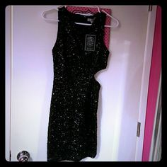 Black sequin cutout dress Brand new.  Still has tag. Super cute with side cutout. Size medium but runs small. Dresses Mini
