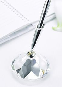 """Bring on the bling in a big way with this sparkling diamond-cut pen set! The faceted, glass base includes a silver-tone pen that writes in black ink. Features and Facts:   2 3/4"""" diameter  Glass base with silver-tone pen  $22"""