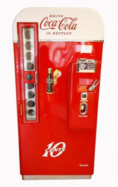 1957 V-81 Coca-Cola Machine - with an 81 bottle capacity this classic machine vends beautifully chilled glass bottles of Coca-Cola.