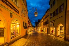 Shopping in Rothenburg - At the blue hour in this marvelous medieval city Rothenburg ob der Tauber, the crowd of tourist already were away and only locals and people hosted in romantic hotels were there. The atmosphere is completely different, very romantic. Do shopping here is much more about souvenirs than necessities. I loved it!
