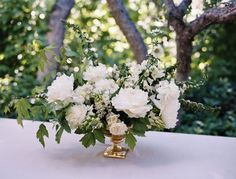 White floral dinner concept (fill in with white dahlias, too) / similar shape, but in gold mercury glass compote vase