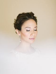 White, Black and Gold Wedding Make up.