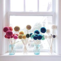 Pom poms are a perfect springtime substitute for flowers on your window sill. Pom Poms - the hottest fashion and home trend. The best pom pom trimmed clothing and home decor picks. Pom Pom Flowers, Pom Poms, Tulle Poms, Diy Flowers, Mason Jar Crafts, Mason Jar Diy, Diy Christmas Tree, Kids Christmas, Diy And Crafts
