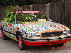 A KEITH HARING lesson creating on a car and upcycling it to be used as a planter.