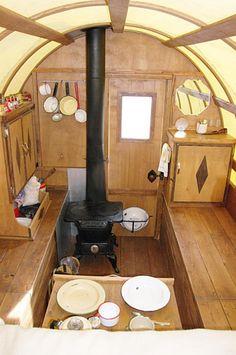 A tiny sheep wagon/gypsy vardo interior...