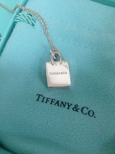 Tiffany & Co. Sterling Silver Shopping Bag pendant. Get the lowest price on Tiffany & Co. Sterling Silver Shopping Bag pendant and other fabulous designer clothing and accessories! Shop Tradesy now